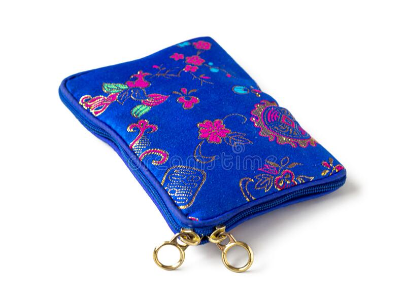 Blue fabric purse with embroidered pattern. Blue fabric wallet with embroidered pattern and zipper lock, isolated on white background royalty free stock photo