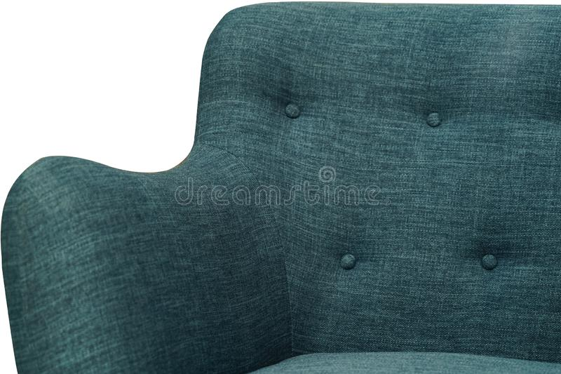 Blue fabric sofa, close up detail with buttons and armchair. Furniture showroom photography royalty free stock photo