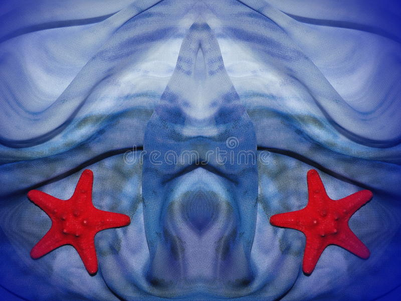 Blue fabric and starfish royalty free stock photos