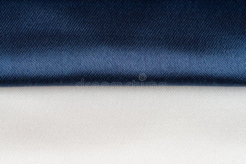 Blue fabric texture. Background made of a closeup of a blue fabric texture stock image