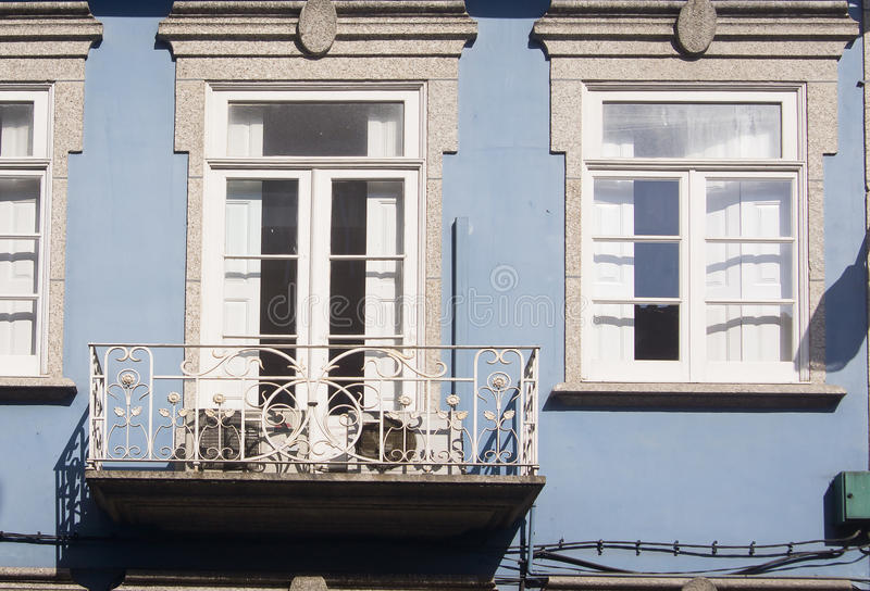 Blue facade Guimaraes Portugal. Blue facade and white window and door Guimaraes Portugal royalty free stock photos