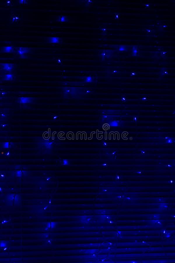 Blue Fairy Lights at Night on Metal Blinds stock photography