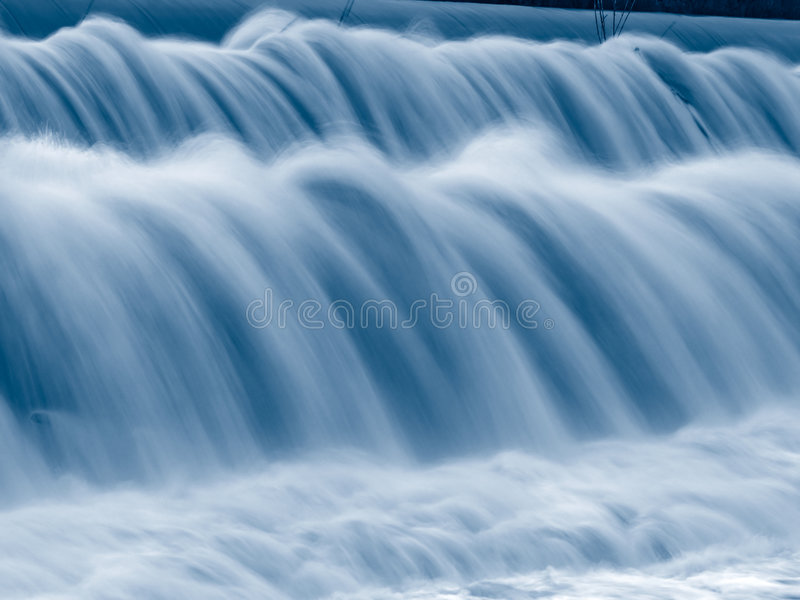 Blue falling water texture stock images