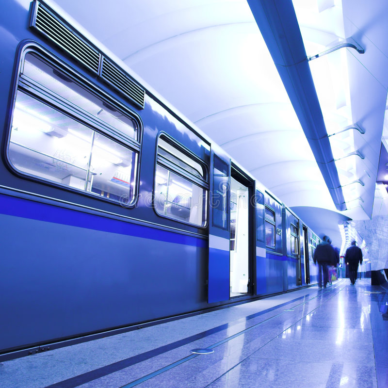 Blue fast train stay at platform royalty free stock photo