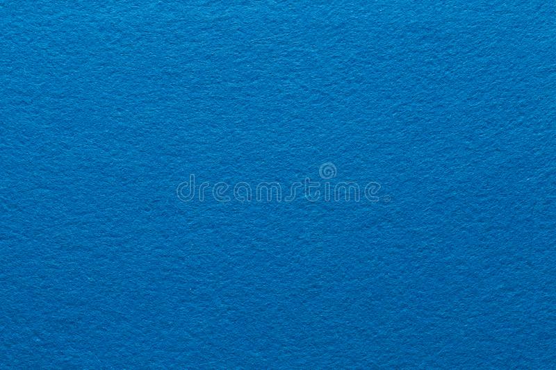 Blue felt texture background solid color paper. Blue felt texture abstract art background. Solid color construction paper surface. Empty space stock image