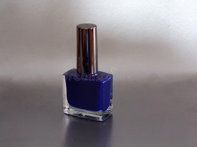Blue female nail Polish. royalty free stock photos