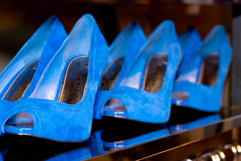 Blue female shoes stock images