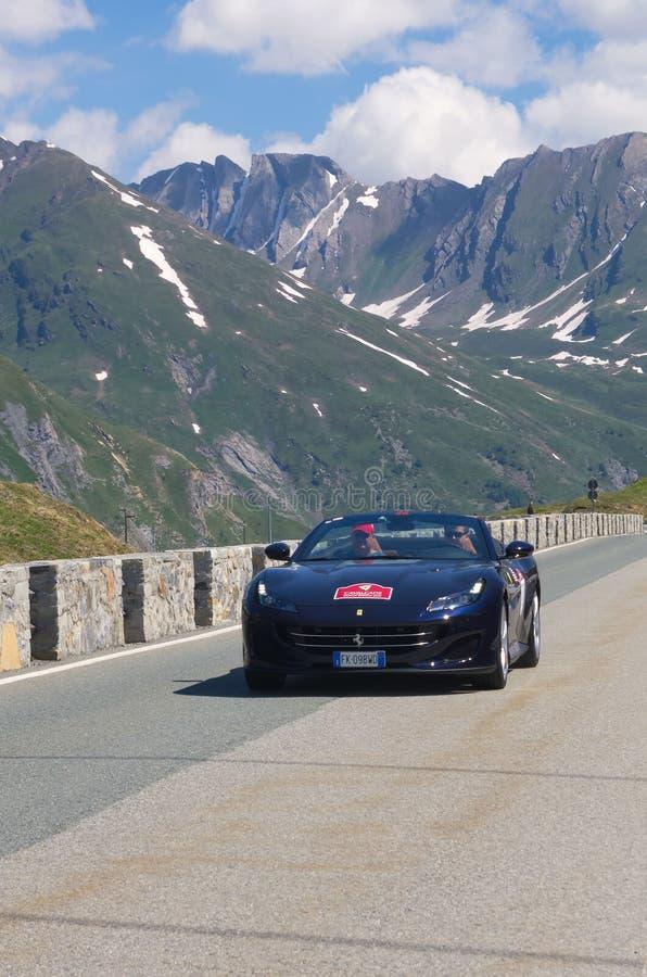 Blue Ferrari in the street. royalty free stock image