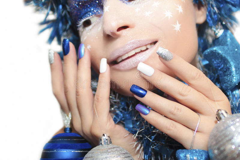 Blue festive manicure. stock photo