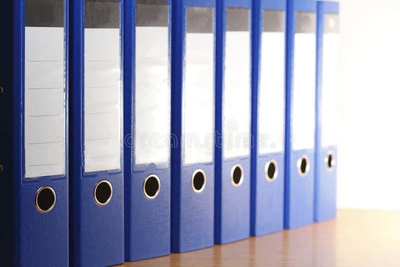 Blue file folders. Many blue file folders in office cabinet royalty free stock image