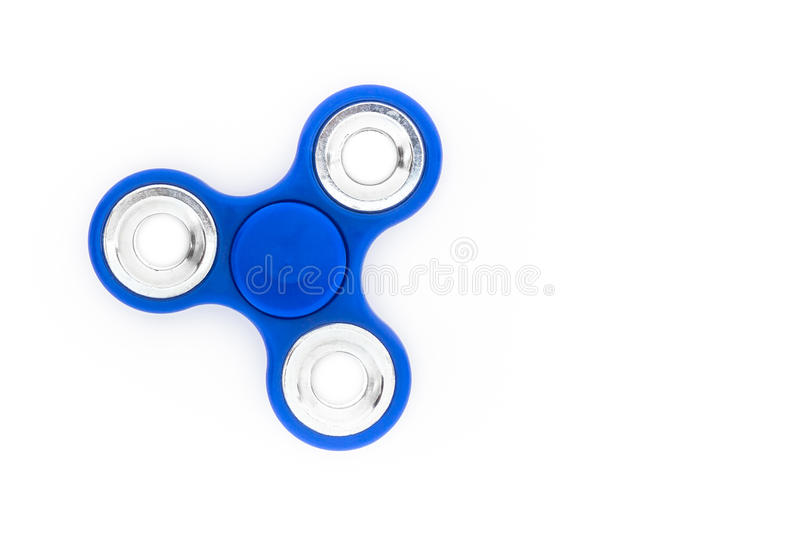 Blue finger spinner. Stress anxiety relief toy isolated on white background. Overhead view royalty free stock images