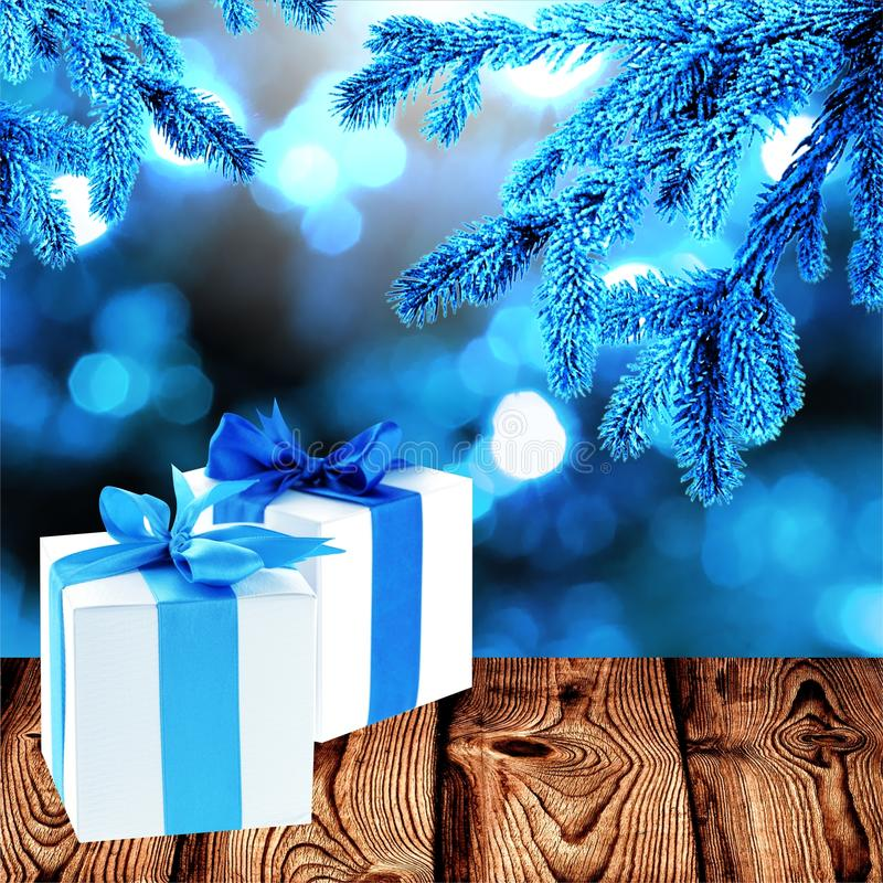 Blue fir branches and gifts stock image
