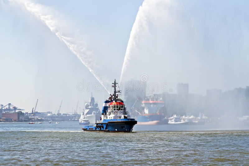 Download Blue Fire Boat Spraying Water In Rotterdam Harbor Netherlands Stock Image - Image: 28352953
