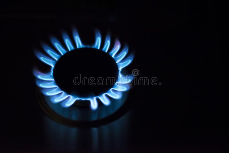 Blue fire in gas burner. Gas burning from a kitchen gas stove stock images
