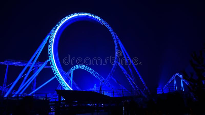 Roller coaster loop lighted by night royalty free stock photography
