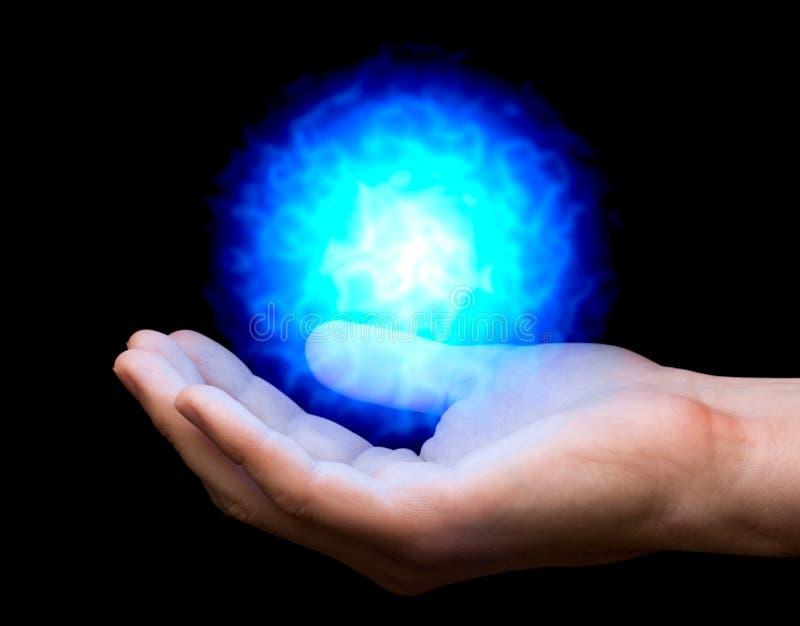 Blue fireball on hand. Blue power fireball on man's hand stock photos