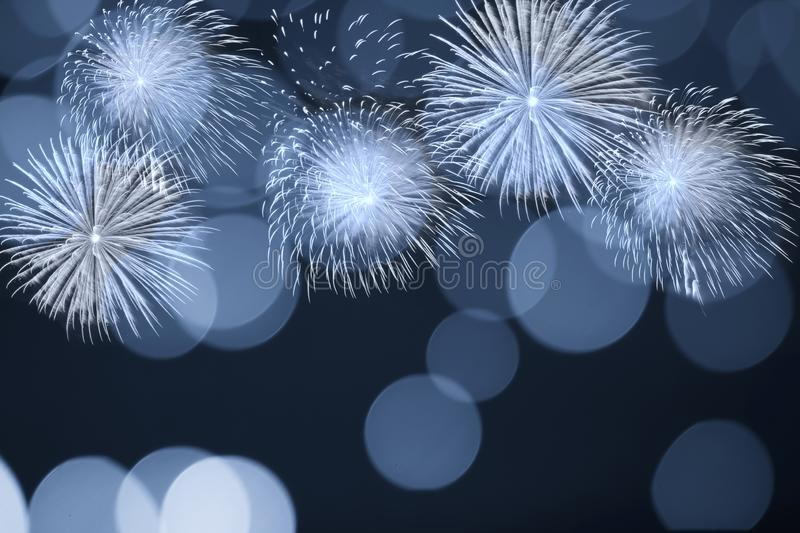 Blue firework and blurred bokeh light with copy space in Christmas and New Year. Abstract background holiday concept. royalty free stock image