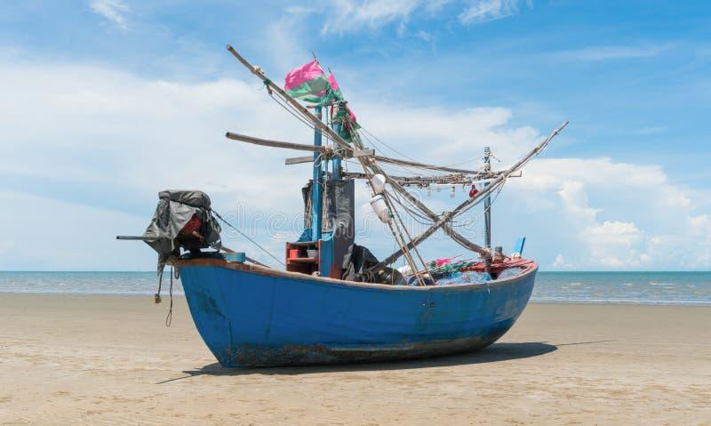 Blue Fishing Boat on Sam Roi Yod Beach Prachuap Khiri Khan Thailand Center 2. Blue fishing boat or fisherman boat or ship on Sam Roi Yod bech Prachuap Khiri Khan stock images
