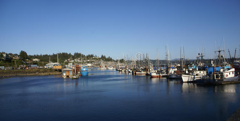 Blue fishing trawlers stock images