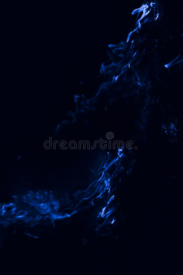 Blue flame. Burning of rice straw at night. Blue flame. Fire. Burning of rice straw at night stock photo