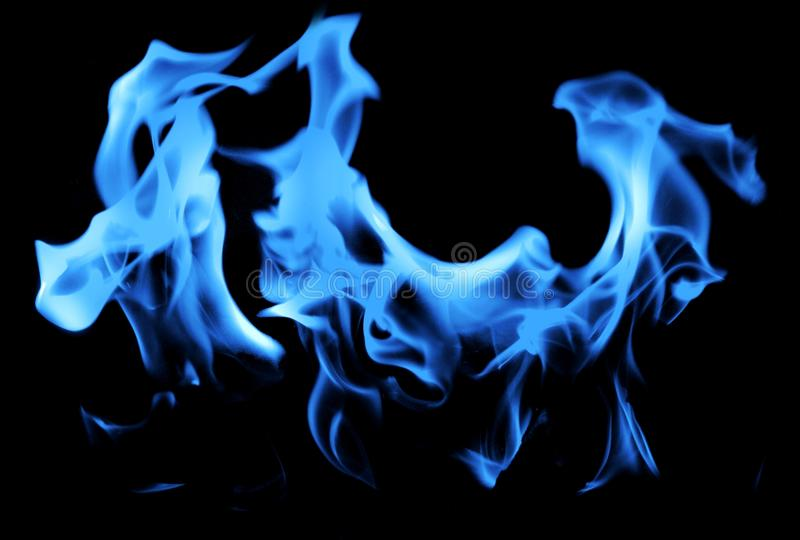 Blue flame of gas on the black background. Gas and oil reserves have played a leading role in world geopolitics. You need to consider these options. The stock photo