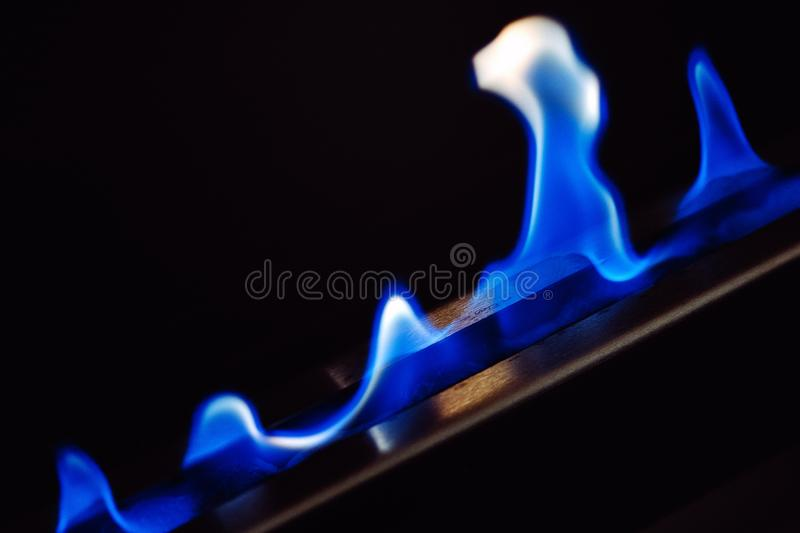 Blue flames of a gas stove fireplace stock photography