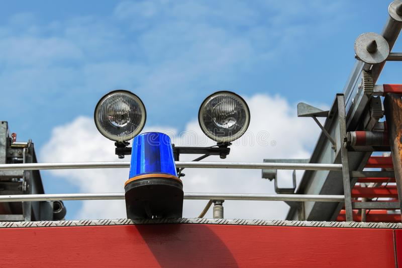 Blue flashing beacon on the roof of a fire truck in the afternoon royalty free stock images