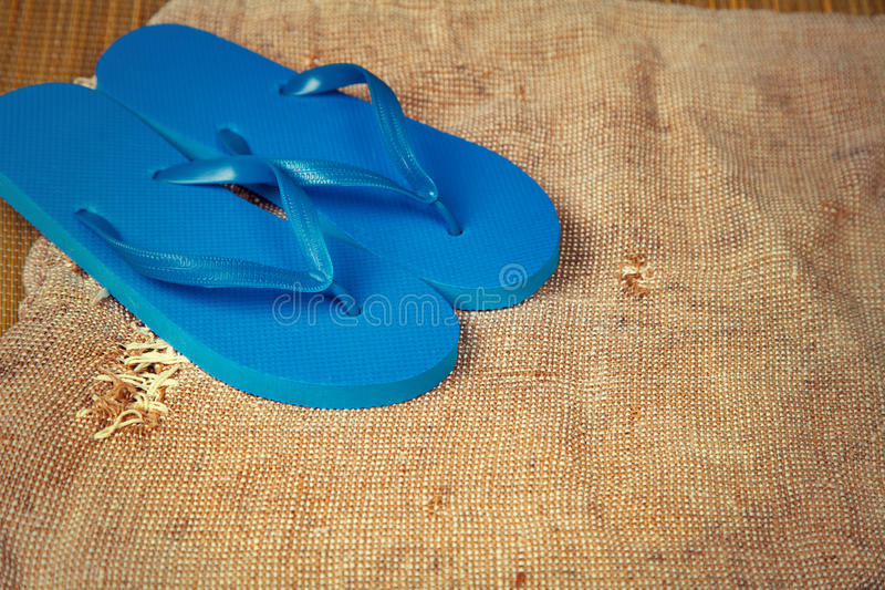 Blue flip flop sandals. Grunge sacking background with flip flop sandals stock photo