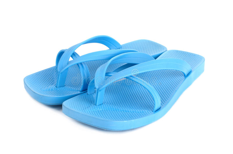 Blue Flip-flops. Pair of blue flip-flop sandals isolated on white royalty free stock image