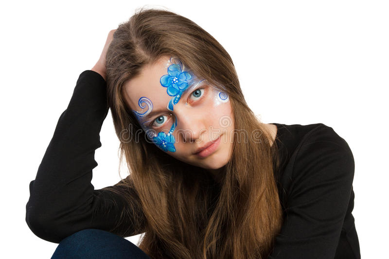Blue floral ornament face painting stock photography