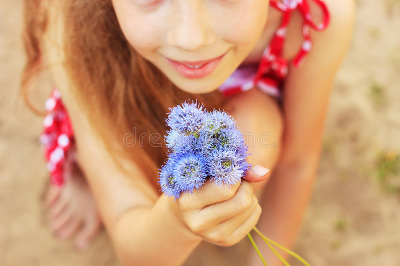 Blue Flowers in girls hand royalty free stock photo
