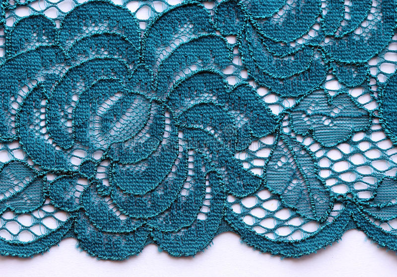 Blue flowers lace material texture macro shot royalty free stock image