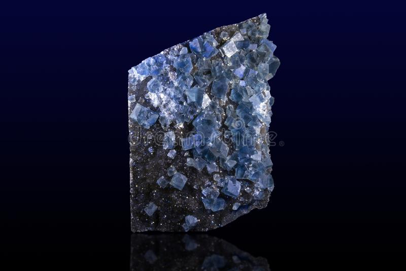 Blue fluorite crystal on the dark background stock photography