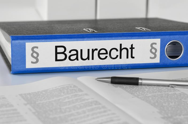 Blue folder with the german label Baurecht - Construction Law royalty free stock photography
