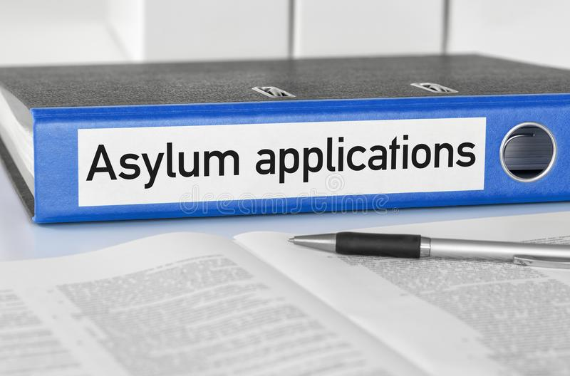 A blue folder with the label Asylum applications stock photo