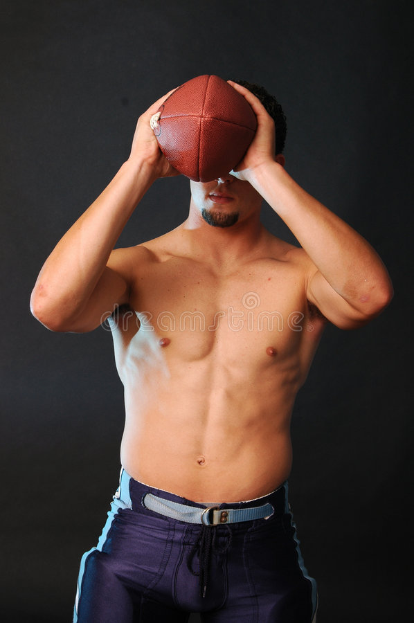 Download Blue Football Holding Football Stock Photo - Image: 1248512
