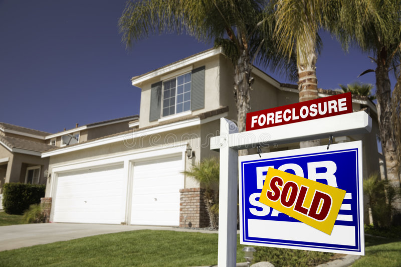 Blue Foreclosure For Sale Real Estate Sign and Hou stock photography