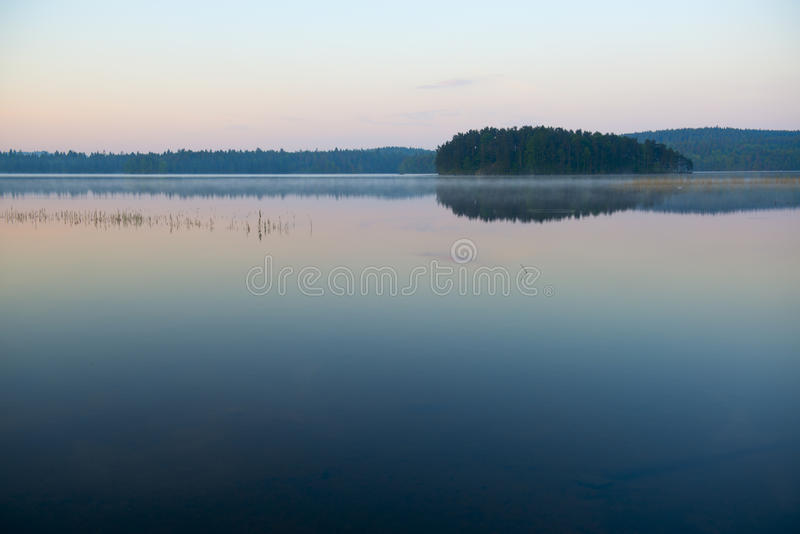 Calm lake at sunset royalty free stock photo