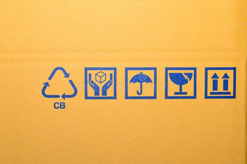 Blue fragile symbol on cardboard stock image