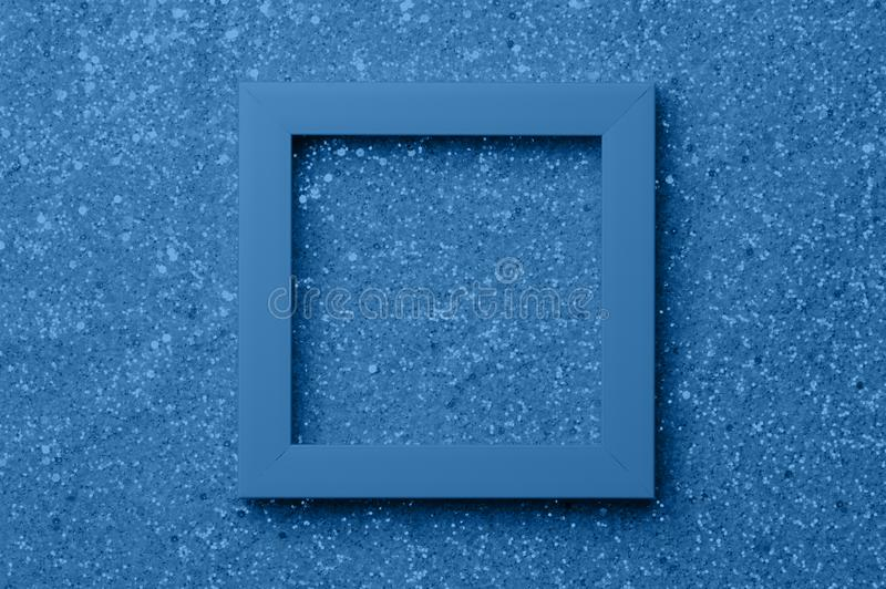 Blue frame for a photo or inscription on a shiny glitter background. royalty free stock images