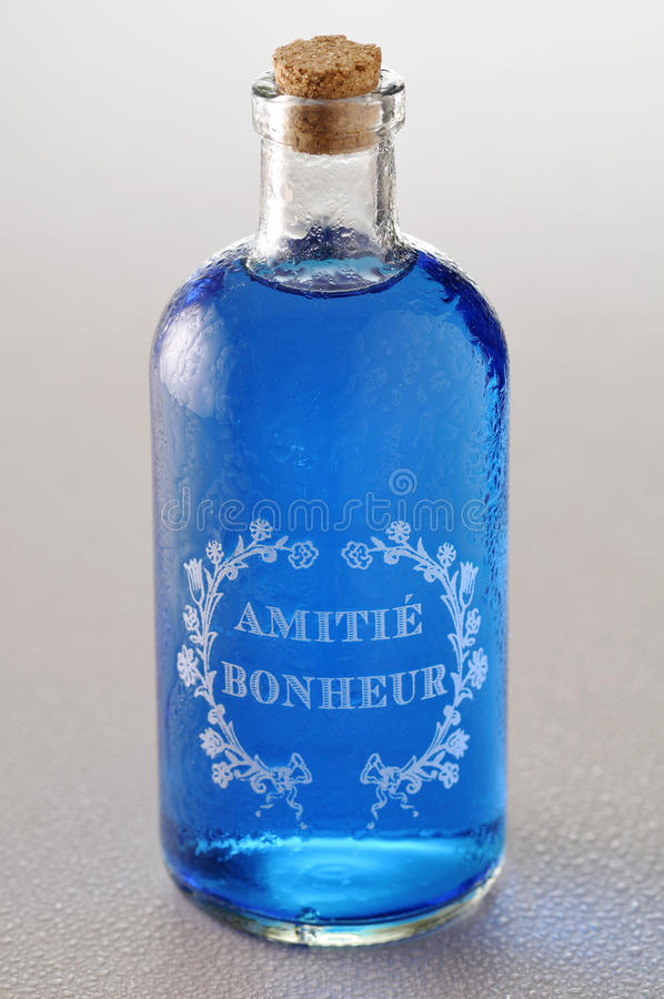 Download Blue Friendship Drink In A Glass Bottle Editorial Stock Image - Image: 23705624