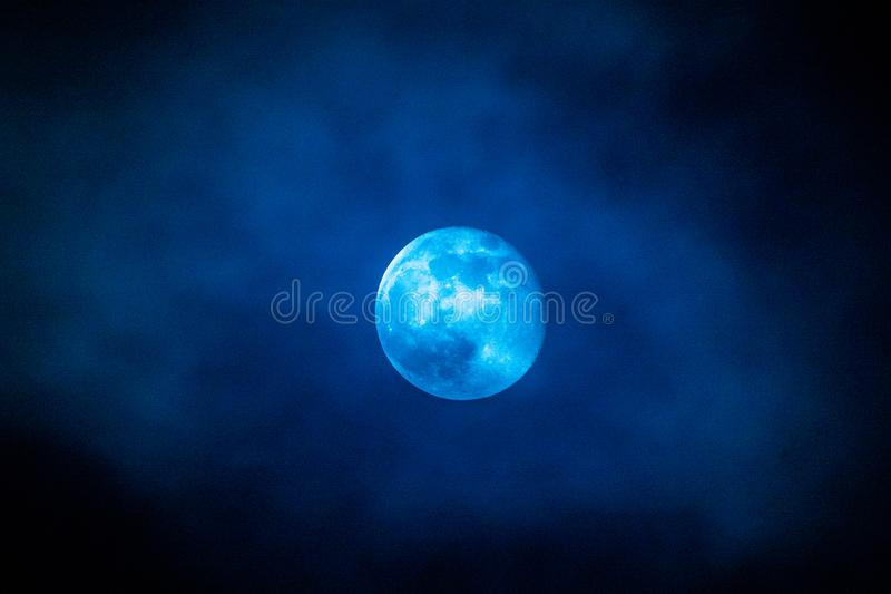 A blue full moon with clouds in february 2019 royalty free stock photos