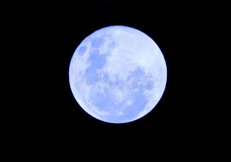 Blue Full moon on the dark night stock images