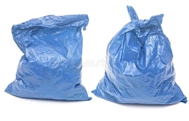 Blue garbage bags. Isolated on a white background stock photography