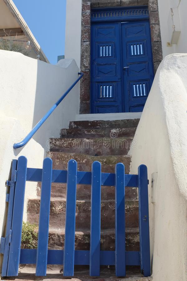 Blue Gate and Steps Leading to Blue Door stock image
