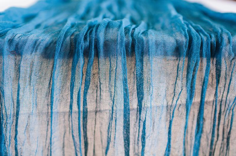 Blue gauze runner for weddings events. Wooden table is covered with a color runner tablecloth with a white plate and cutlery royalty free stock photos