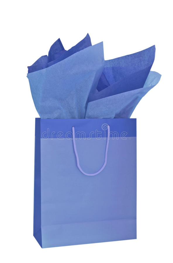 blue gift bag with tissue paper stock photography