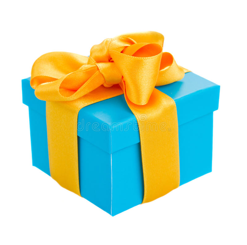 Blue gift box. With yellow ribbon isolated om white background royalty free stock photography