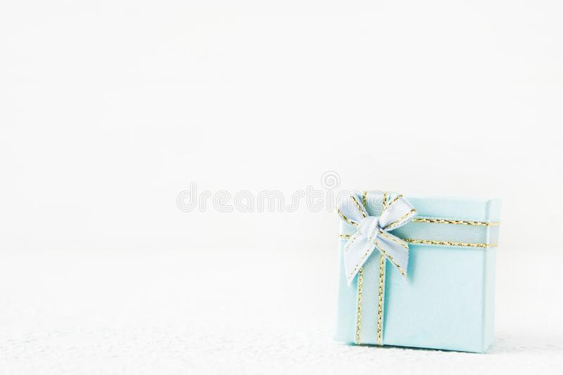 Blue gift box for holiday on light background royalty free stock images