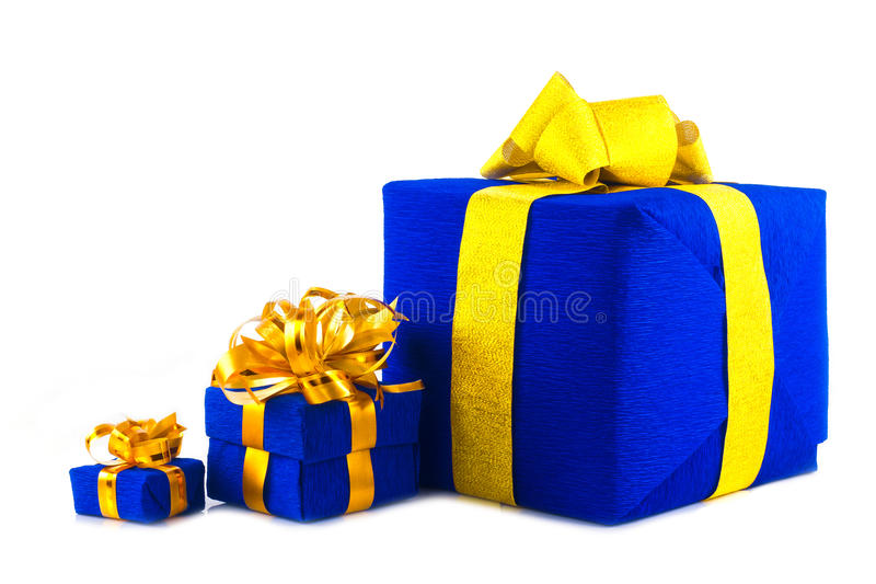 Blue gift box. Many different gift boxes all blue color with a gold bow on a white background for isolation royalty free stock photos